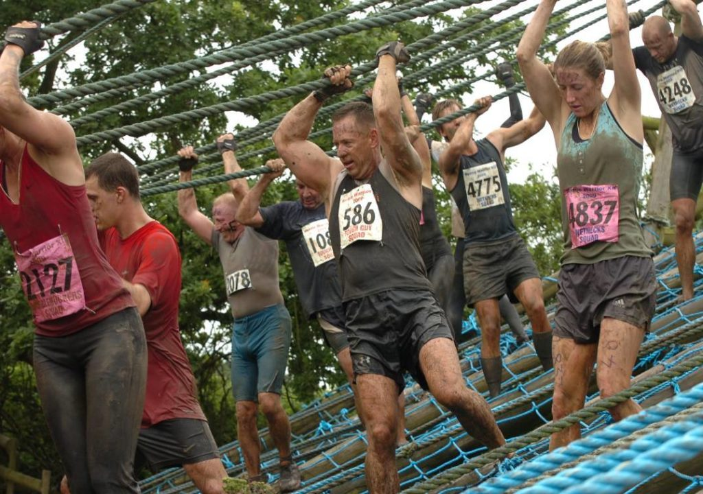 People racing in an obstacle race